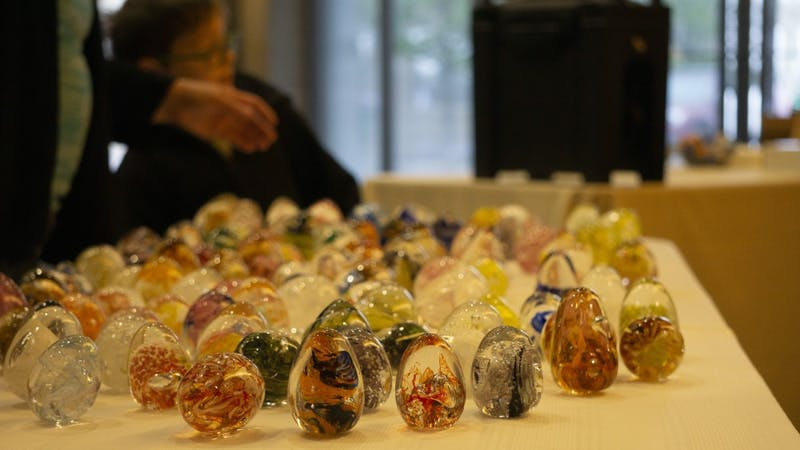 Glass Easter eggs, made by the Ball State Glass Alliance, sit on display on April 20, 2019, at the Minnetrista Gathering Center for the Minnetrista Glass Easter Egg Hunt. Participants were tasked with finding the glass eggs around the gathering center. John Lynch, DN.
