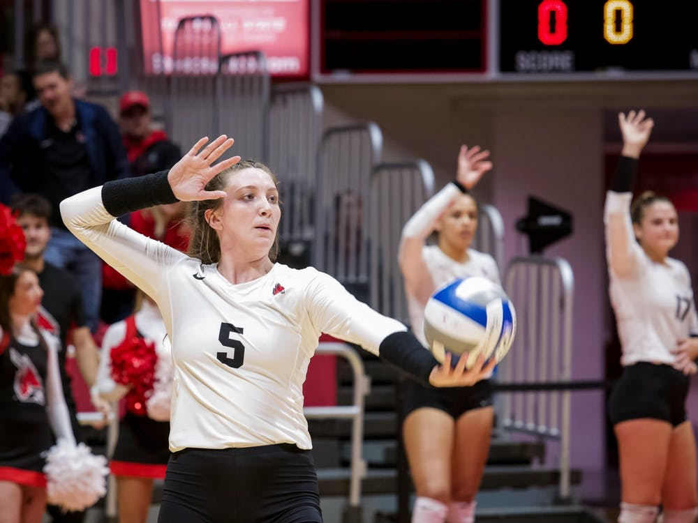Freshman middle blocker, Marie Plitt (5), sets up to serve during the third match against Miami Redhawks on October 25, 2019, at John E. Worthen Arena. Miami defeated the Cardinals 3-0. Omari Smith, DN