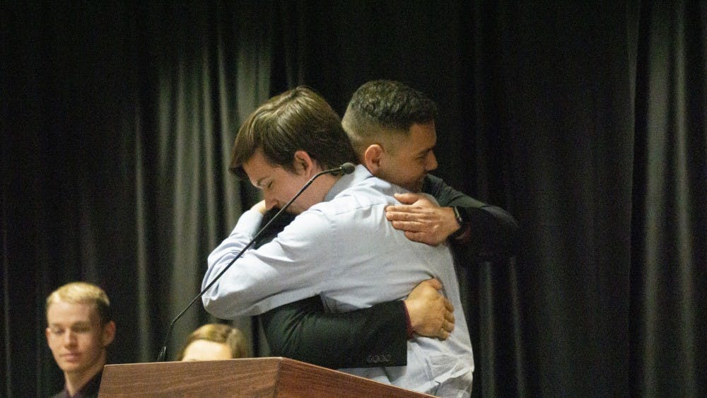 Former Student Government Association President Isaac Mitchell congratulates newly inaugurated President Aiden Medellin. Elevate was inaugurated April 17, 2019, at the L.A. Pittenger Student Center. John Lynch, DN