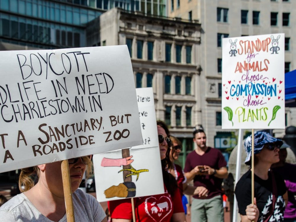 Animal activists hold signs at the Animal Rights March on Sept. 1, 2018 at Monument Circle in downtown Indianapolis. The event is to raise awareness of the abuse animals go through for human benefit. Leslie Gartrell, DN