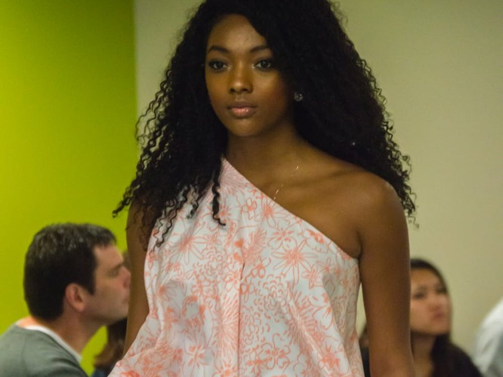 Family and friends watched the Fashion Design Soceity host a fashion show on April 1 in the Applied Technology Building. Since 1997, the organization helps fashion students develop their skills. Terence K. Lightning Jr. // DN