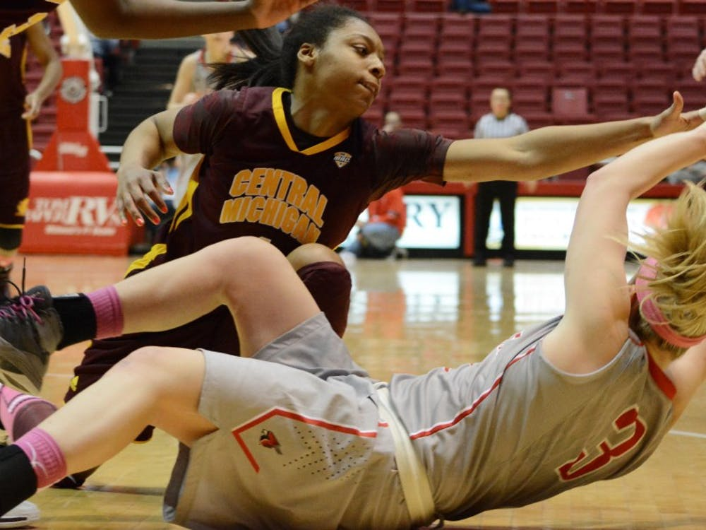 Junior Shelbie Justice grabs for the ball against a Central Michigan player on Feb. 6 in Worthen Arena . Ball State fell to Central Michigan. DN PHOTO SAMANTHA BLANKENSHIP