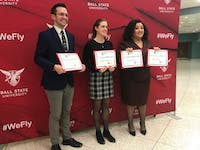 (Left) Byron Long, Kirsten Vacura and Dayna Arnett competed in the Graduate School's inaugural Three Minute Thesis competition. Vacura finished first, winning $1,000 for her thesis about how anglers contribute to the spread of invasive aquatic species.Hannah Gunnell, DN