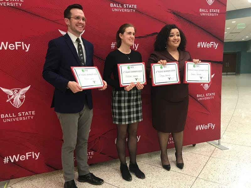 (Left) Byron Long, Kirsten Vacura and Dayna Arnett competed in the Graduate School's inaugural Three Minute Thesis competition. Vacura finished first, winning $1,000 for her thesis about how anglers contribute to the spread of invasive aquatic species. Hannah Gunnell, DN