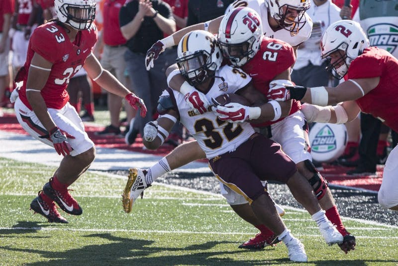 Running back Berkley Edwards is brought down at the 40-yard line by redshirt freshman linebacker Brandon Martin during the first half of Ball State's homecoming game against Central Michigan, Oct. 21 at Scheumann Stadium. Central Michigan defeated Ball State, 9-56. Grace Hollars, DN