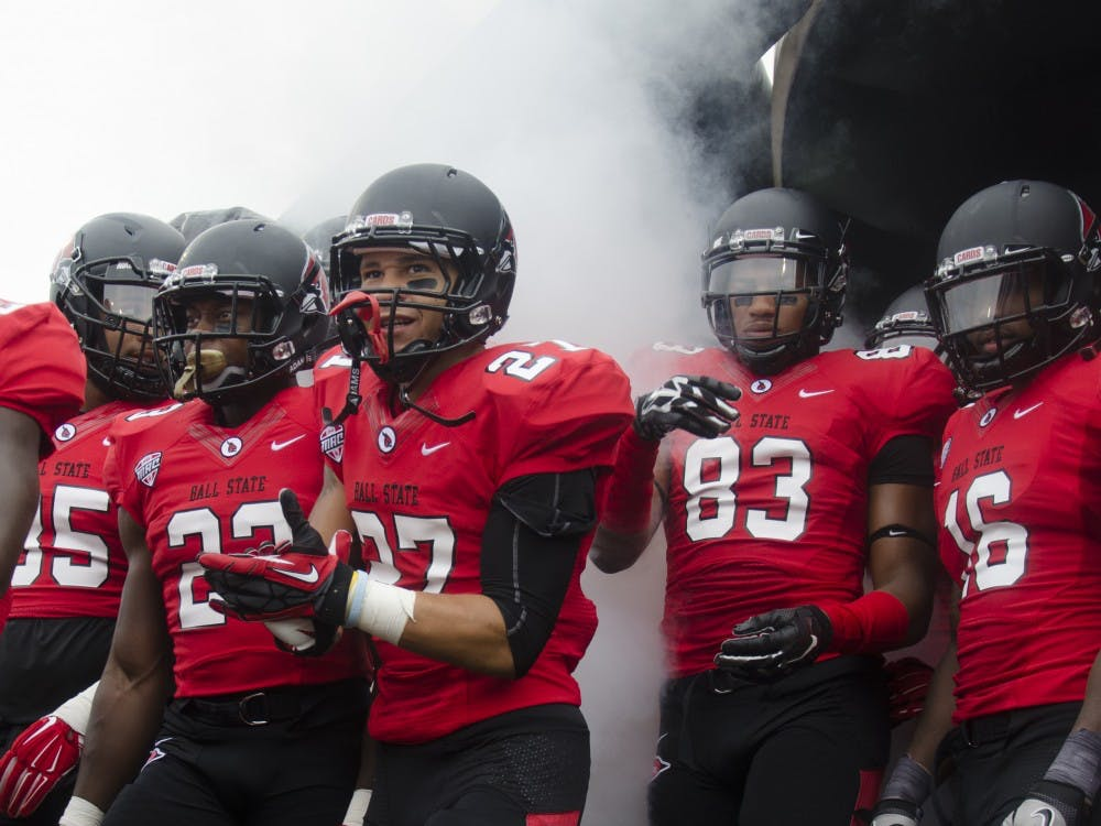 Members of the Ball State football team get ready to take the field before the start of the home opener against Colgate on Aug. 20 at Scheumann Stadium. DN PHOTO BREANNA DAUGHERTY