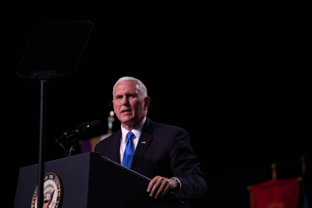 Pence speaks at Taylor University commencement, draws mixed reactions