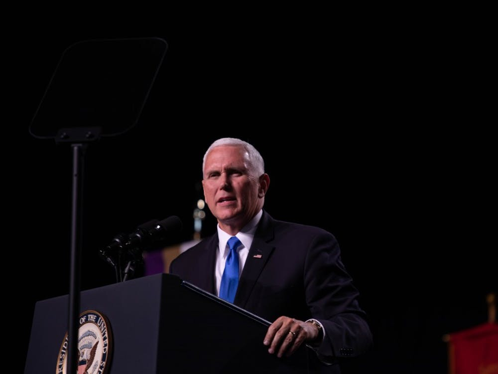 Vice President Mike Pence delivers his speech at Odle Arena on the campus of Taylor University May 18, 2019 during the 2019 commencement. Before Pence began his speech, during a song, some students and faculty walked out. Scott Fleener, DN