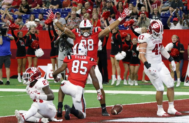 Ball State redshirt junior tight end Nolan Givan and sophomore wide receiver Yo'Heinz Tyler celebrate after Tyler's touchdown during the Cardinals' game against Indiana Aug. 31, 2019, at Lucas Oil Stadium. Tyler had 71 receiving yards. Paige Grider, DN