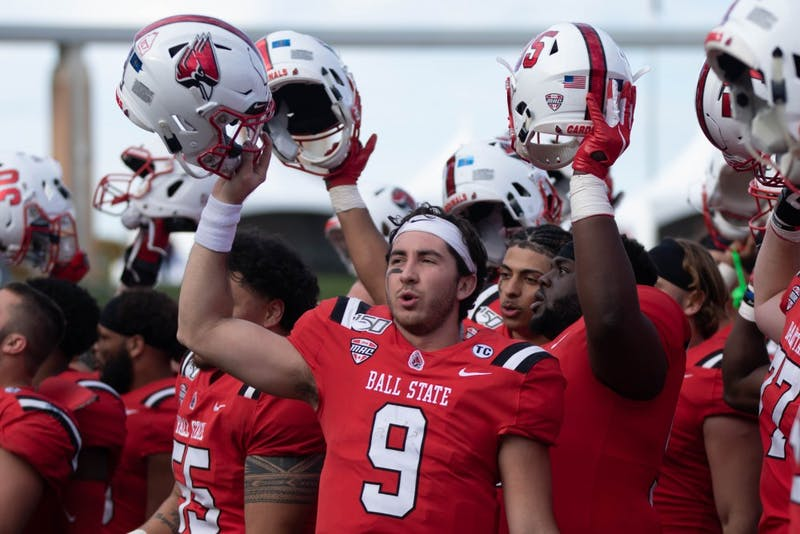 Redshirt Junior Quarterback Drew Plitt sings the Ball State fight song with his team Oct. 19, 2019 at Scheumann Stadium. Plitt had 206 yard against the Toledo Rockets. Jacob Musselman, DN