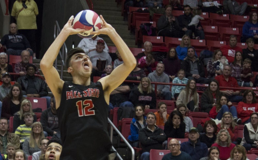 <p>Ball State men's volleyball player Jake Romano sets the ball during the first game against Loyola University on Feb. 17 at John E. Worthen Arena. Romano had two aces, three blocks, 44 assists, and 13 digs during the four games. <strong>Briana Hale, DN</strong></p>