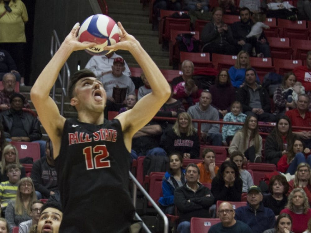 Ball State men's volleyball player Jake Romano sets the ball during the first game against Loyola University on Feb. 17 at John E. Worthen Arena. Romano had two aces, three blocks, 44 assists, and 13 digs during the four games. Briana Hale, DN