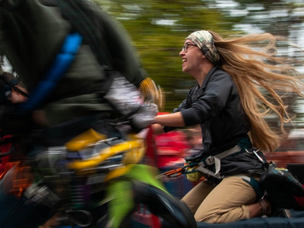 Members of Ball State's Climb Club compete in Bed Races Oct. 19, 2018, on Riverside Ave. The entire block of Riverside is shut down during this hour every Homecoming weekend. Madeline Grosh,DN