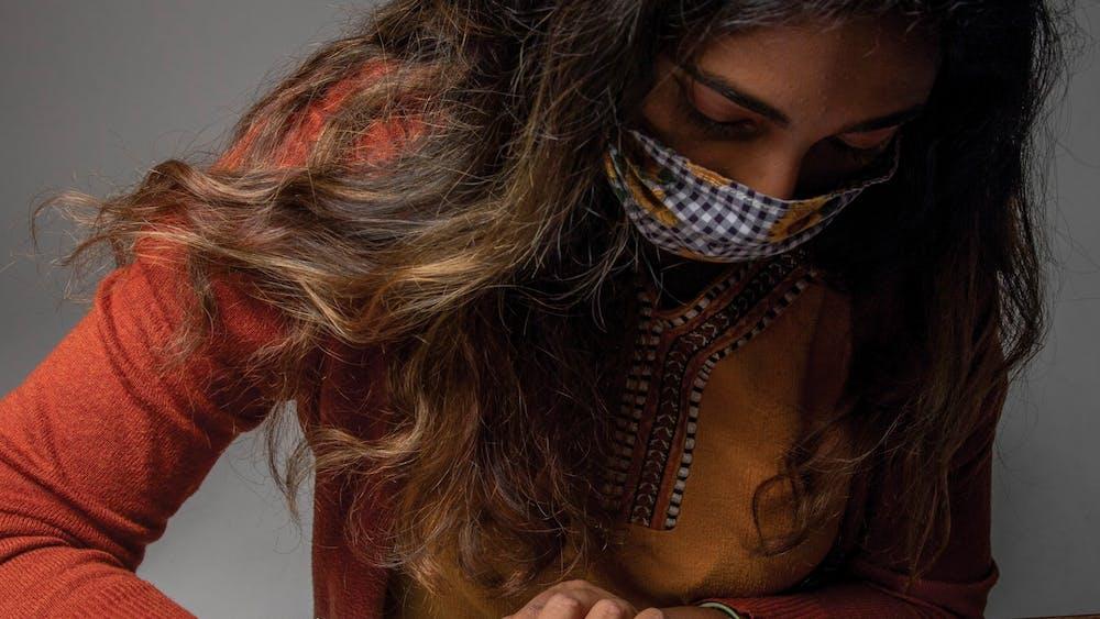 Shwetha Sundarrajan writes down misspellings of her name Nov. 3, 2020, in the photojournalism studio. Throughout Sundarrajan's life, her name has been misspelled and misspoken. Jacob Musselman, DN Illustration