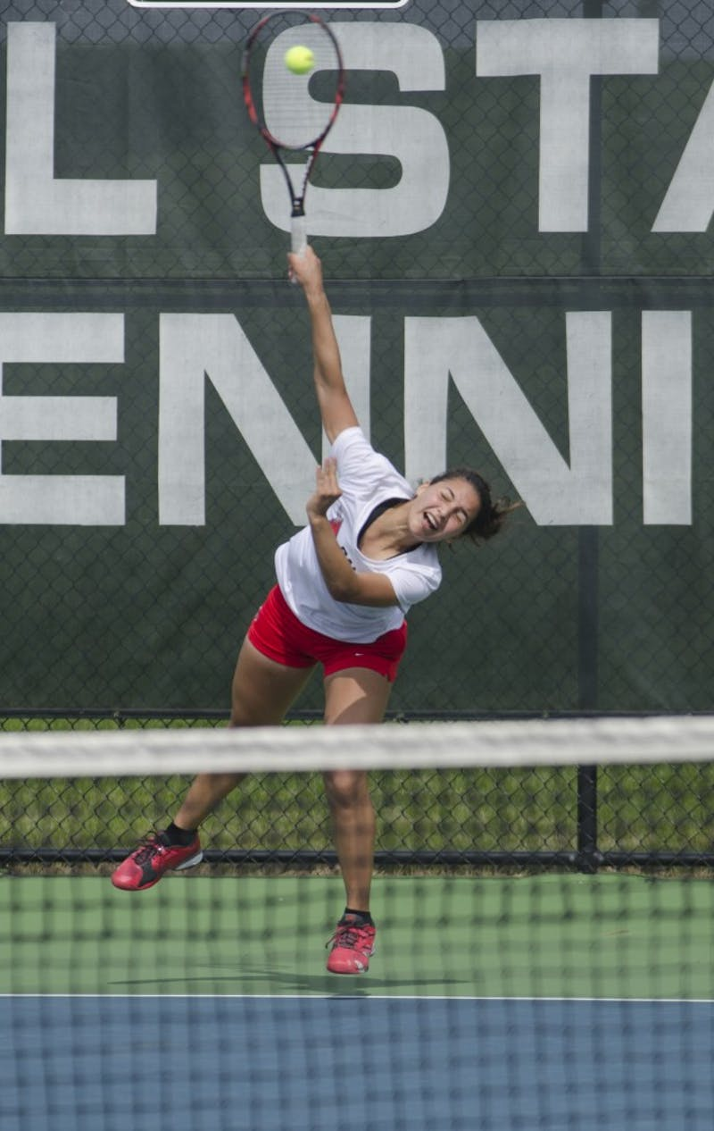 Sophomore Rosalinda Calderon serves the ball during the doubles match against Butler for the Fall Dual on Sept. 20 at the Cardinal Creek Tennis Center. Calderon and her partner senior Courtney Wild won 8-6. DN PHOTO BREANNA DAUGHERTY