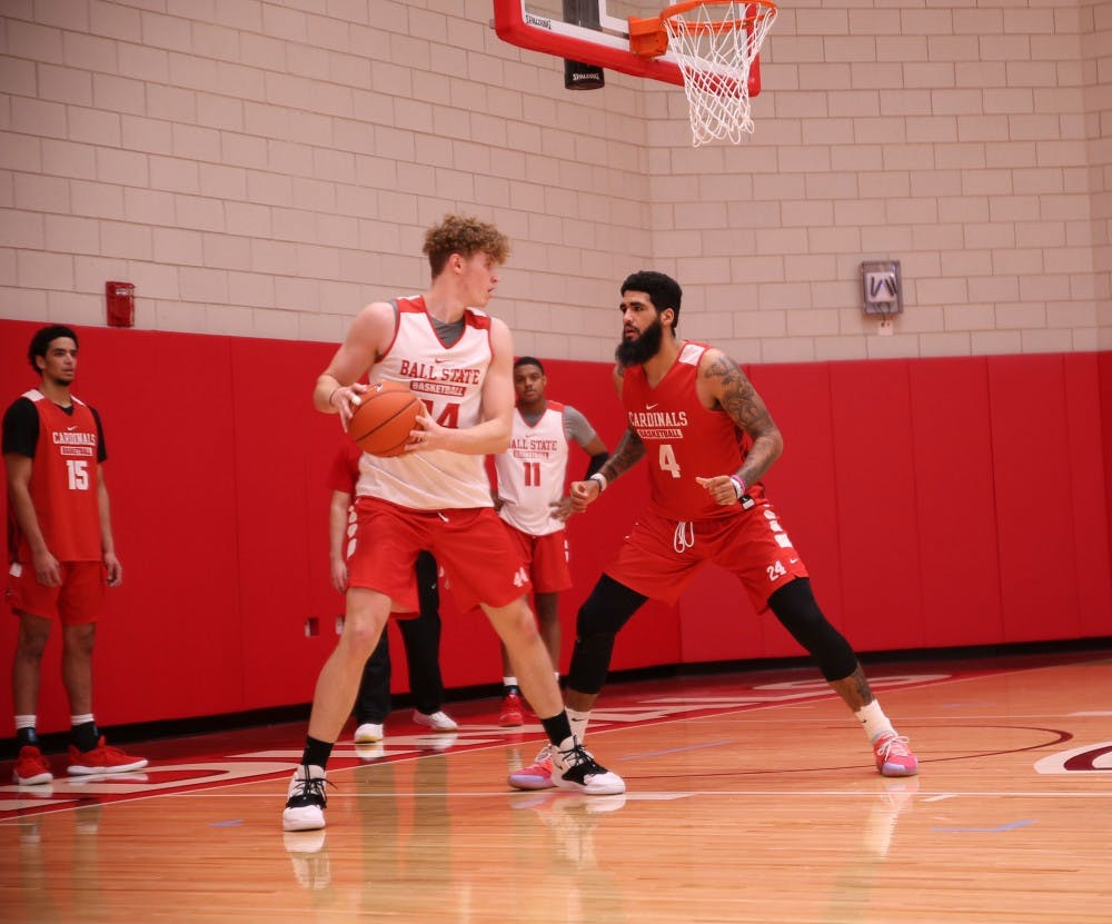 Redshirt senior Trey Moses defends redshirt freshman center Blake Huggins during a practice at Dr. Schondell Practice Center on Nov 29, 2018. Jack Williams,DN