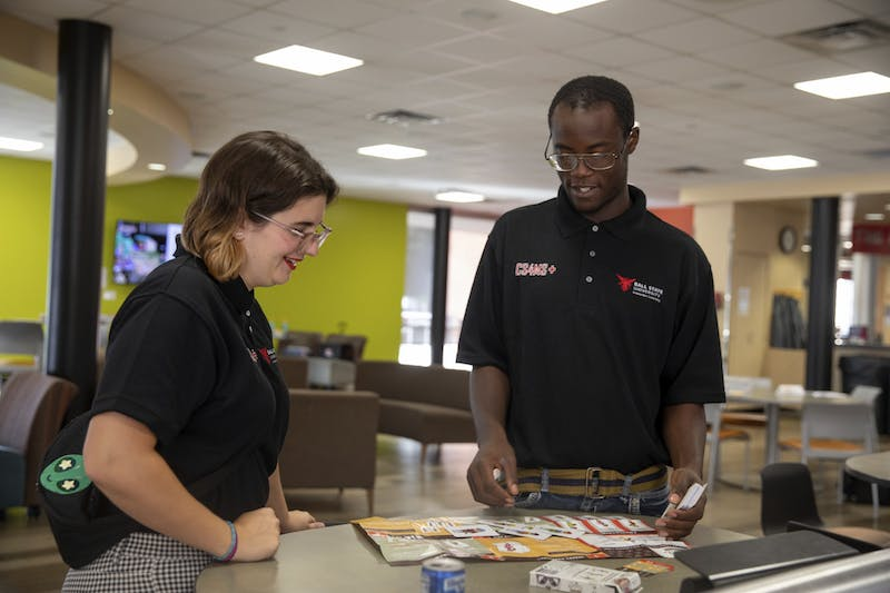 CS4MS+ students Gwyn Hultquist and Brian Walker engage in conversation at a computer science conference in Indianapolis Sept. 16, 2019. CS4MS+ aims to provide students with real-world teaching experience. Robbie Mehling, Photo Provided