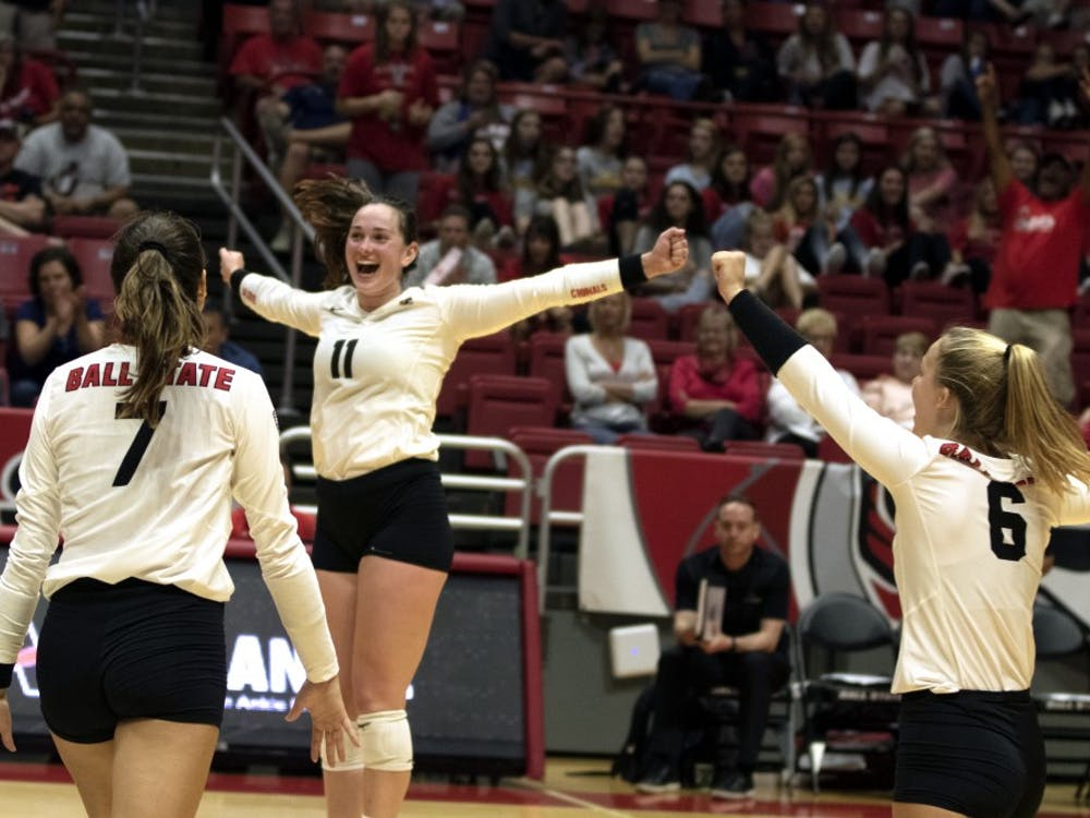 Natalie Risi (7), Amber Seaman (11), and Maggie Huber (6)  celebrate winning their second match against Austin Peay on September 20, 2019, at Worthen Arena. Ball State continued on to win 3-0. Jaden Whiteman, DN
