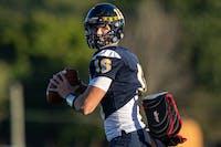 Delta senior quarterback Brady Hunt practices throws during pregame Sept. 18, 2020, at Delta High School. The Eagles lost to the Mt. Vernon Marauders 35-0. Jacob Musselman, DN