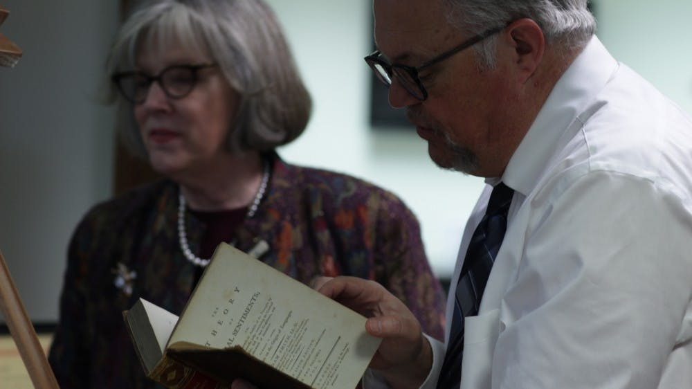 """<p>Cecil Bohanon examines """"The Theory of Moral Sentiments"""" by Adam Smith Jan 23. The book is a first edition copy and is part of the Remnant Trust collection, which is currently &nbsp;on exhibit at the E.B. Ball Center. <strong>Ryan Shank, DN</strong></p>"""
