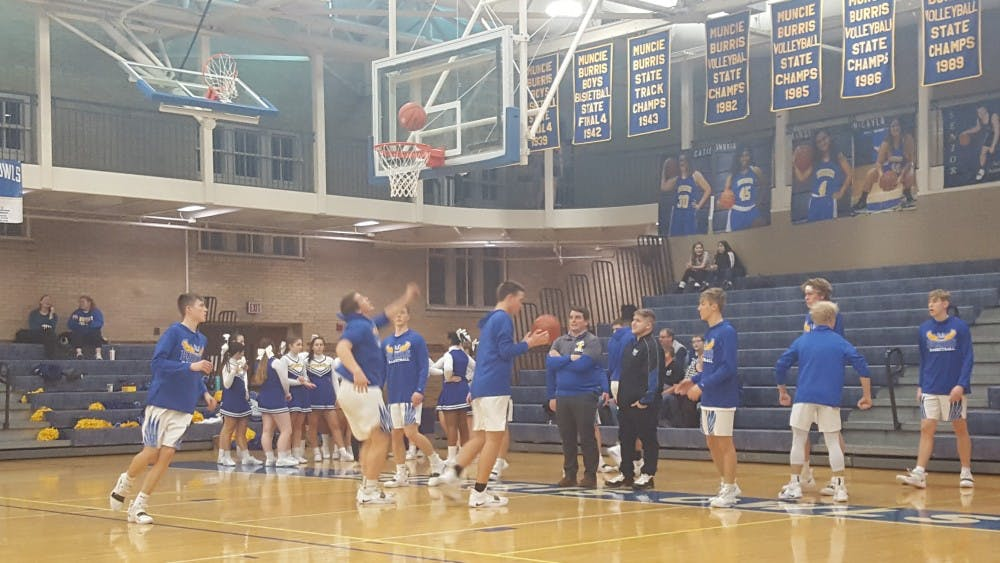 Burris High School warms up before its game against Alexandria-Monroe Feb. 7 at Ball Gymnasium. The Owls fell to the Tigers, 63-50. Zach Piatt, DN