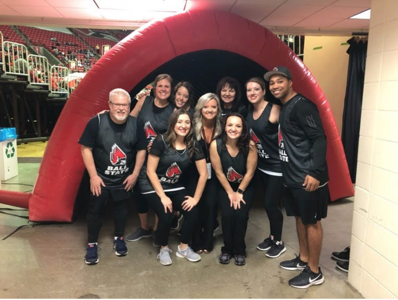 The Ballers, faculty and staff dance team, pose before taking the floor during a men's basketball game on Feb. 9. The team is made up of Mike Gillilan, Jessica Allardt, Michelle Jones, Candace Olszak, Larissa Wright, Blake Beemer Stormie Kirby and Renee Haack. Olivia McGarvey, Photo Provided