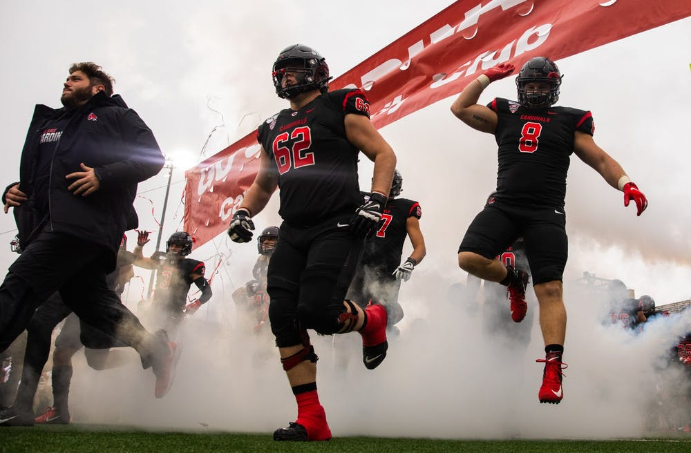 <p>Ball State Football players run onto the field during pregame against the Miami Redhawks Nov. 29, 2019, at Scheumann Stadium. Ball State beat Miami, 41-27. <strong>Jacob Musselman, DN</strong></p>