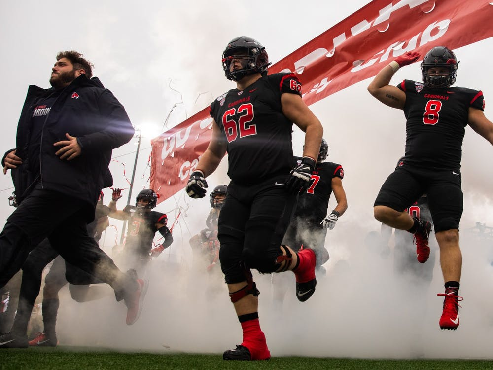 Ball State Football players run onto the field during pregame against the Miami Redhawks Nov. 29, 2019, at Scheumann Stadium. Ball State beat Miami, 41-27. Jacob Musselman, DN