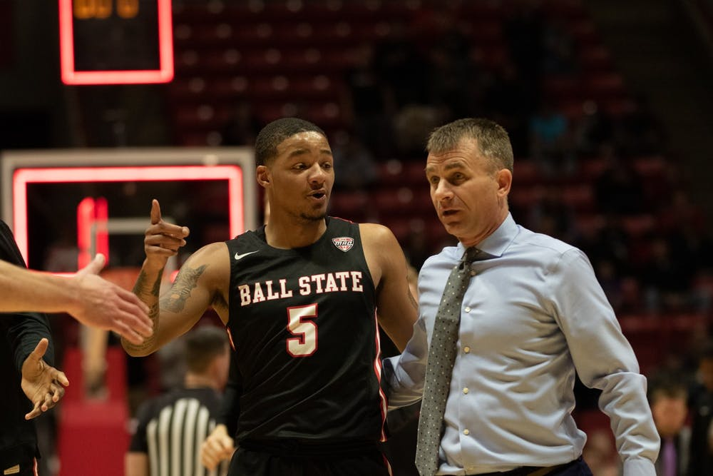 <p>Junior guard Ishmael El-Amin walks to the locker room with Head Coach James Whitford at halftime Jan. 7, 2020, at John E. Worthen arena. Ball State beat Buffalo 88-68. <strong>Jacob Musselman, DN</strong></p>