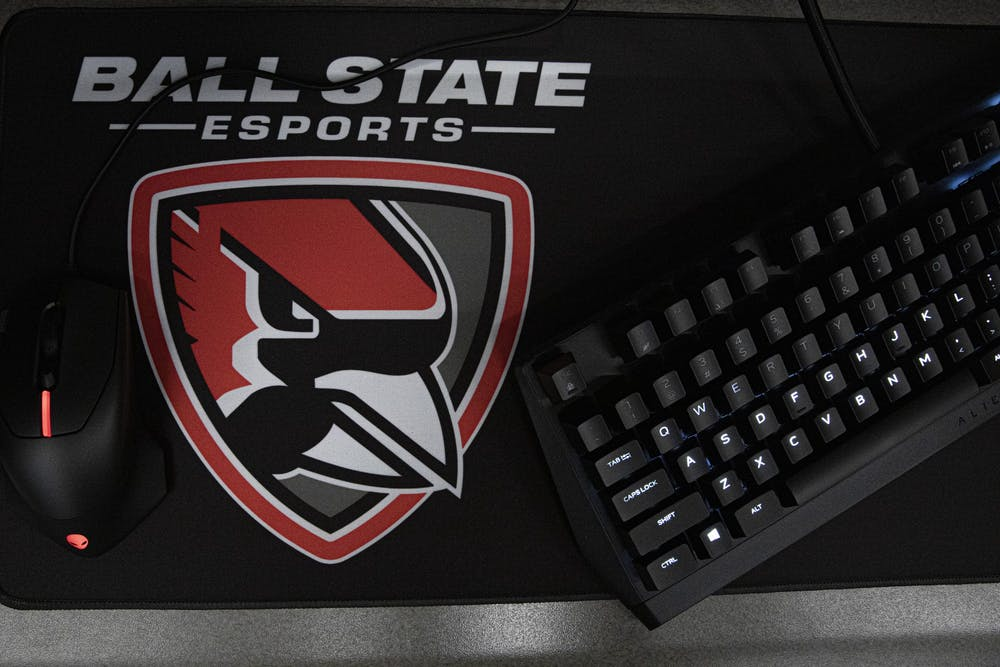 The mousepad with the Cardinal ESports logo sits on a desk March 29, 2021, in the ESports Arena. The new ESports team is a member of the ESports Collegiate Conference which includes all 12 Mid-American Conference schools and Northwestern. Jacob Musselman, DN