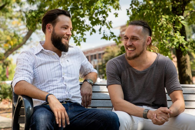 Josh Vandiver and Henry Velandia laugh during an interview in the Quad Sept. 13, 2019. The couple battled laws that would have deported Venezuelan Velandia even though he was married to Vandiver, who is a U.S. citizen. Eric Pritchett, DN
