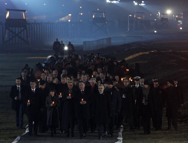 Diginitaries arrive to put candles at a memorial site Jan. 27, 2020, at the Auschwitz Nazi death camp in Oswiecim, Poland. Survivors of the Auschwitz-Birkenau death camp gathered for commemorations marking the 75th anniversary of the Soviet army's liberation of the camp, using the testimony of survivors to warn about the signs of rising anti-Semitism and hatred in the world today. (AP Photo/Czarek Sokolowski)