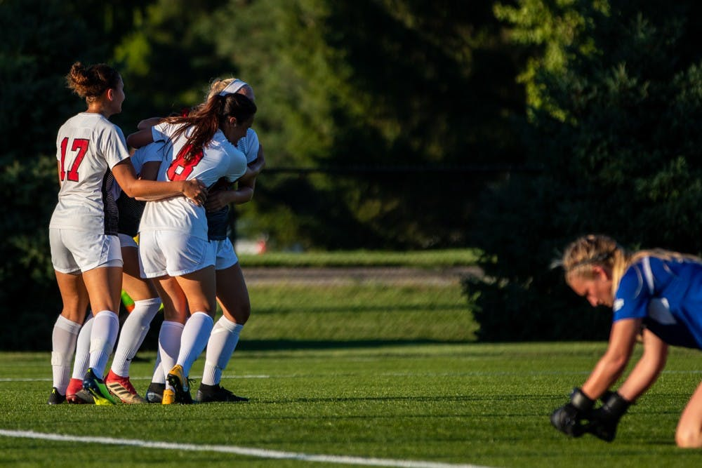 Ball State's soccer team celebrates after Tatiana Mason scored a goal putting the Cardinals in the lead during the second half of the game against the University of Nebraska-Omaha on Friday, Sept. 14, 2018 at Briner Sports Complex. Ball State went on to defeat Omaha 3 to 1 with all goals being scored in the second half of the game. Eric Pritchett,DN