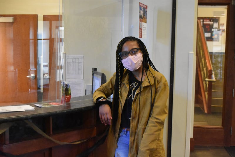 Junior psychology major Nykasia Williams stands by the front desk in Park Hall where she has worked as a desk staff member for two years. Williams helps Park Hall residences with any issue they have from lost keys to checking out equipment. Grace Duerksen, DN