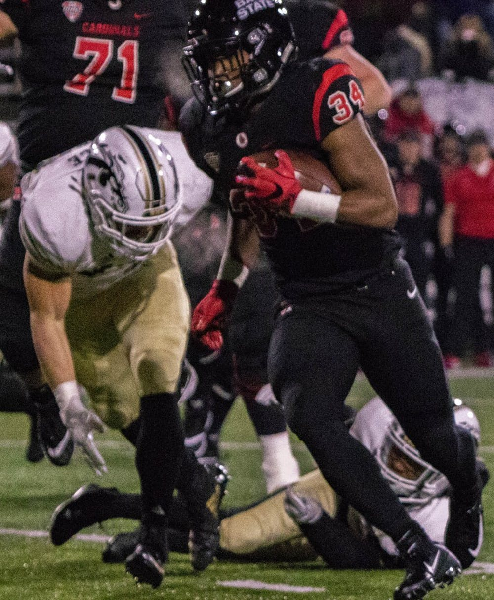 <p>Ball State redshirt junior running back James Gilbert breaks away from Western Michigan defenders late in the second quarter Tuesday, Nov. 13 at Scheumann Stadium. The Cardinals won the game, 42-41 in overtime. <strong>Sharpe L. Marshall,DN</strong></p>