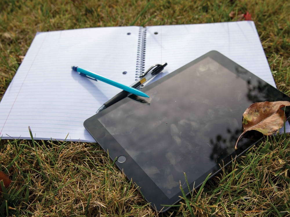 "Different studying materials lay on the grass Oct. 14, 2020, in Noblesville, Indiana. Tutors and Supplemental Instruction Leaders at the Learning Center offer tutoring and study sessions for students looking for help with ""historically difficult"" classes. Jacob Musselman, DN Illustration"