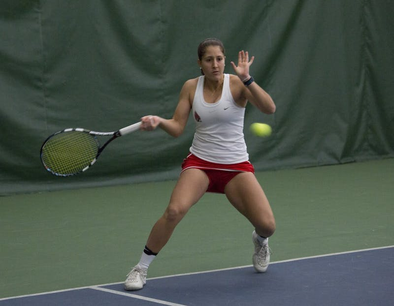 Senior Carmen Blanco hits a forehand during her singles match against Wright State on Feb. 5. Emma Rogers // DN
