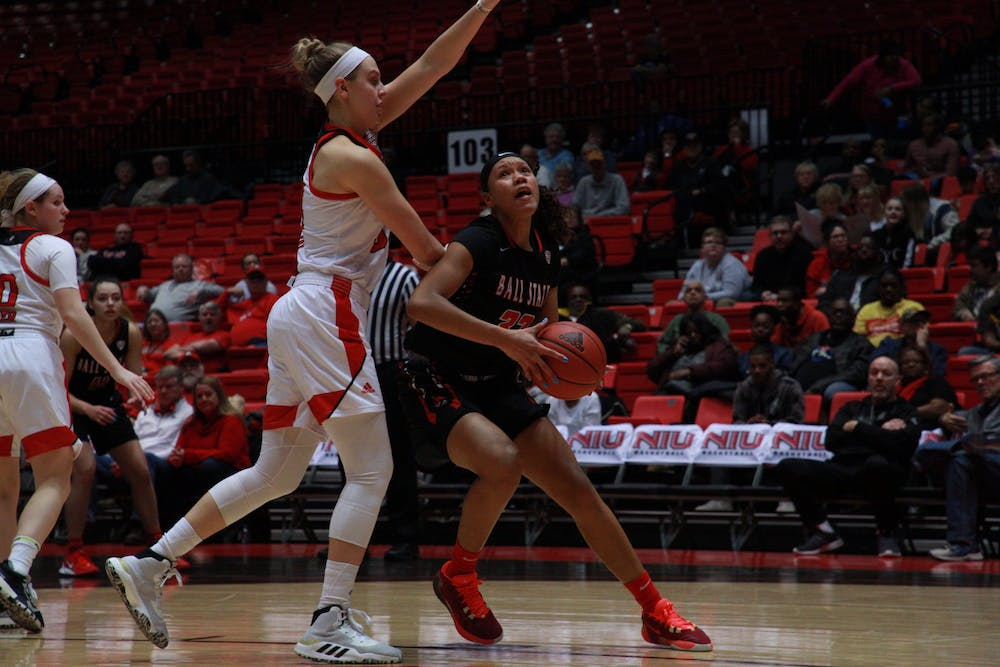<p>Junior forward Oshlynn Brown fends off an NIU player as she looks for a basket in a game against the Huskies on March 4 at the Convocation Center. Ball State lost the game 70-62. <strong>Jack Williams, DN&nbsp;</strong></p>