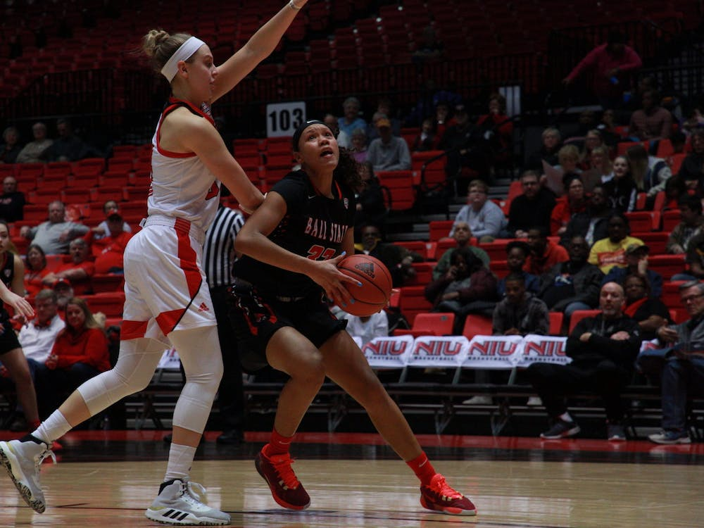 Junior forward Oshlynn Brown fends off an NIU player as she looks for a basket in a game against the Huskies on March 4 at the Convocation Center. Ball State lost the game 70-62. Jack Williams, DN
