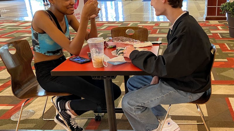 Indiana Academy juniors Simone-Mone't Brown and Jameson VanBelkum have lunch at the Student Center Starbucks May 10, 2021. The Student Center Tally Food Court and Starbucks are the only dining options on Ball State's campus open for all summer months. Grace McCormick, DN