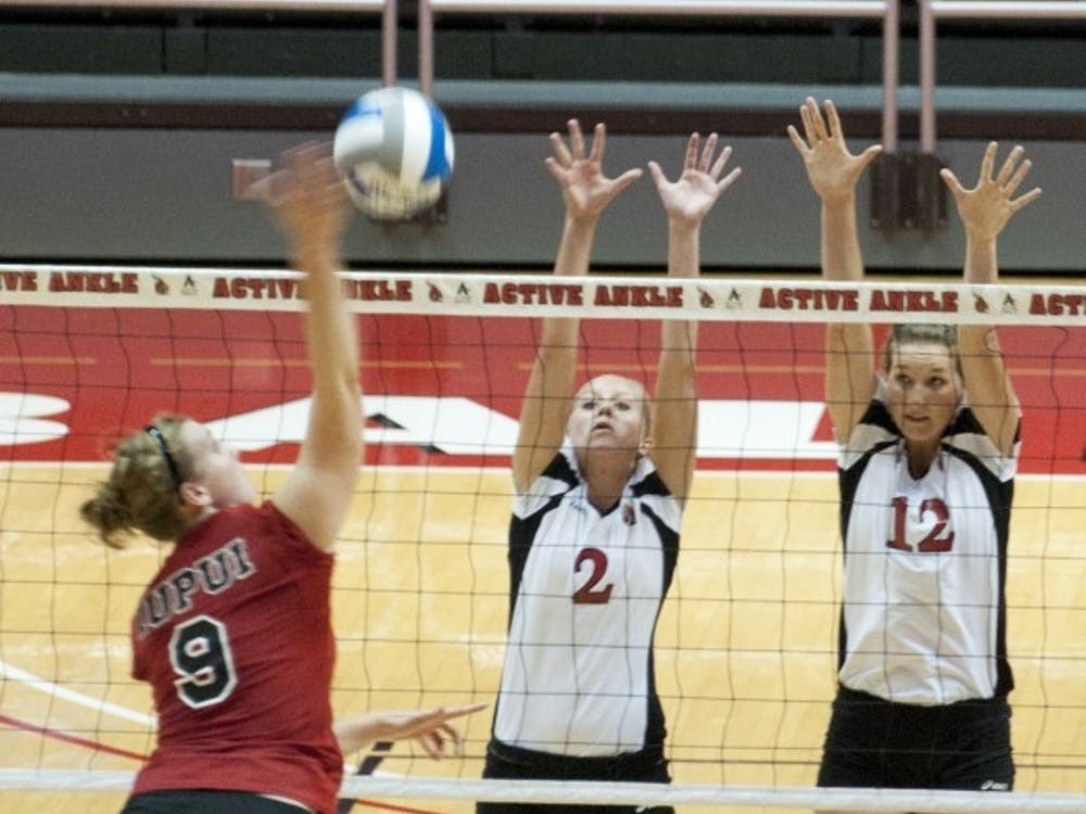 Brittany McGinnis and Jennifer Boyd attempt to block a spike by an IUPUI hitter earlier this season. Ball State defeated Appalachian State 3-2 at Chapel Hill, NC Saturday. DN FILE PHOTO BOBBY ELLIS
