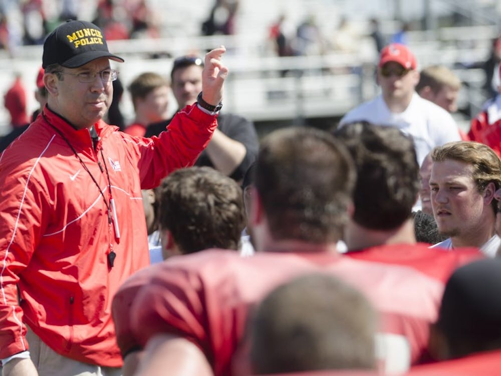 Head coach Pete Lembo talks to the football team after the spring game on April 19 at Scheumann Stadium. DN PHOTO BREANNA DAUGHERTY