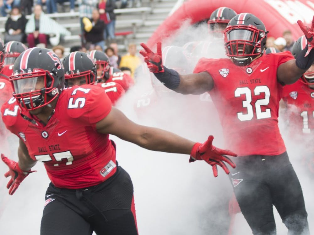 Ball State players rally together before the opening quarter against Northern Illionis University on Saturday, October 1 at Scheumann Stadium in Muncie, IN. NIU defeated the cardinals, 31-24. (DN, Grace Hollars)