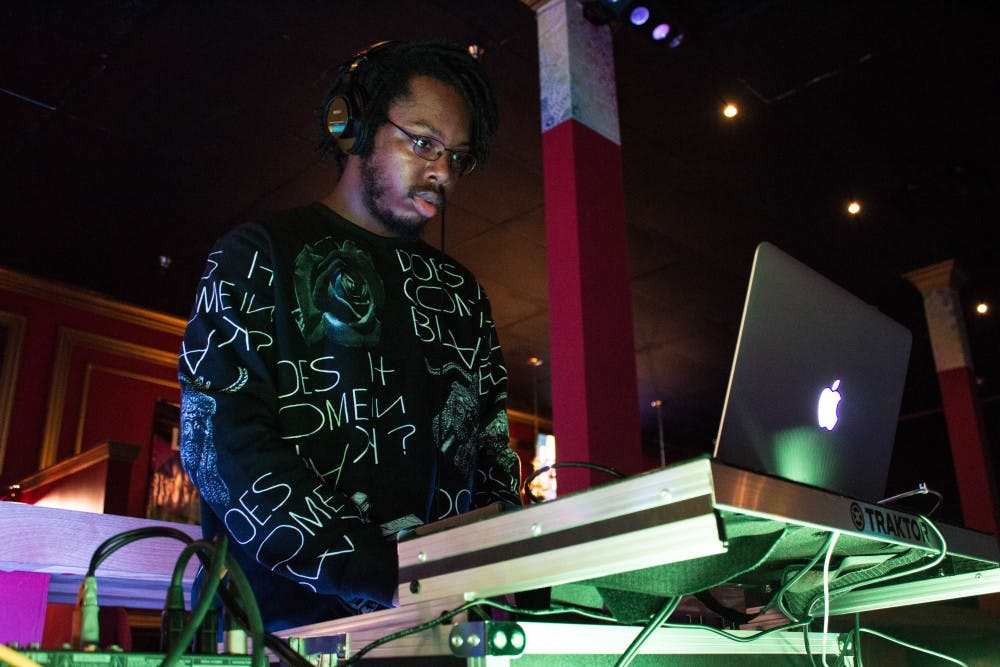 <p>DJ Lavonte 'SPACExLION' Pugh sets audio levels while setting up for Dance This Mess Around on Jan. 21 at Mark III Taproom in downtown Muncie.&nbsp;Pugh will be one of the featured performers at Lantern EDM Night, a&nbsp;choreographed light show, at Be Here Now tonight. <em>Grace Ramey // DN File</em></p>
