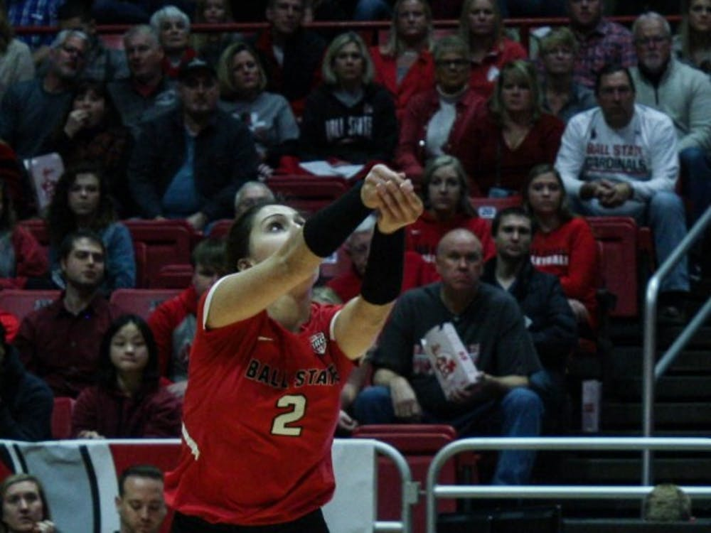 Junior defensive specialist Kate Avila bumps the ball as it comes over the net at the Ball State women's volleyball match versus Akron University Nov.10, 2018 at John E. Worthen Arena. Avila had two assists at the end of the game. Tailiyah Johnson,DN