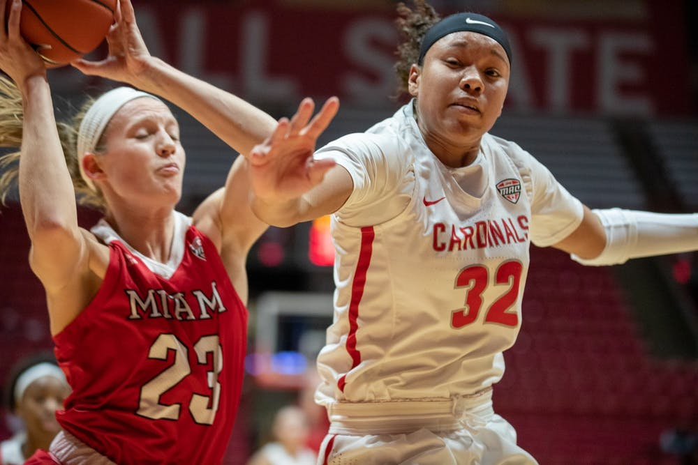 <p>Junior forward Oshlynn Brown (32) loses a rebound to Junior guard Kenzie Schmitz, Jan. 25, 2020, in John E. Worthen Arena. Schmitz had five points against the Cardinals. <strong>Jacob Musselman, DN</strong></p>