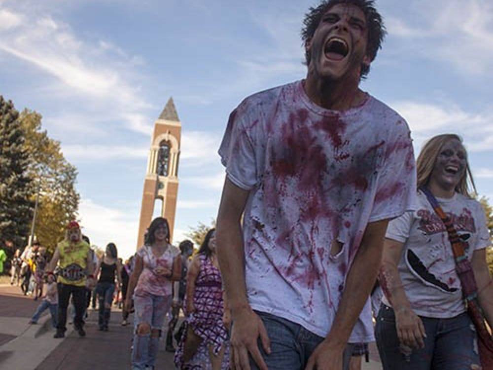 Zombie Walk participants make their way back to Ball State's Quad on Sept. 14. The undead members raised awareness and money for Second Harvest Food Bank and Animal Rescue Fund. DN PHOTO COREY BAUTERS