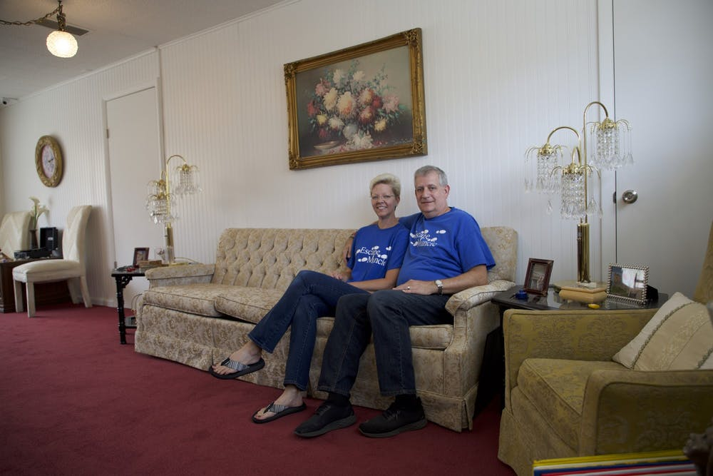 <p>Jennifer and Bruce Everetts sit in the lobby of The Adventures of Gilbert and Maude — Escape Muncie&#x27;s newest location — Aug. 23, 2021. The lobby features 1920s-themed decor to set the scene for the escape rooms. <strong>Grace McCormick, DN</strong></p>