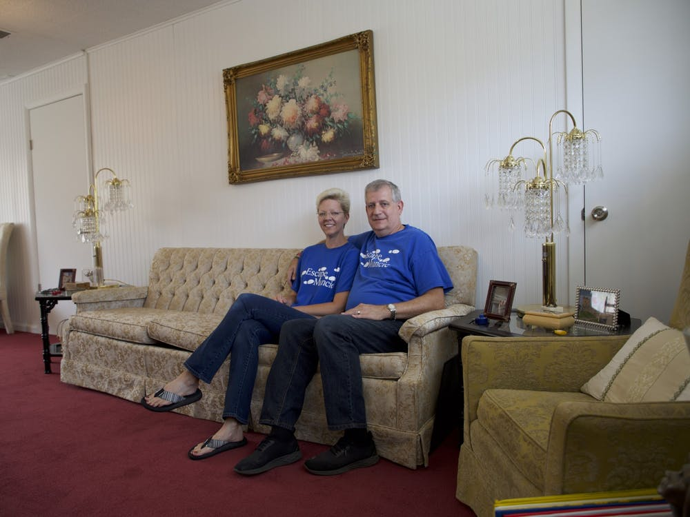 Jennifer and Bruce Everetts sit in the lobby of The Adventures of Gilbert and Maude — Escape Muncie's newest location — Aug. 23, 2021. The lobby features 1920s-themed decor to set the scene for the escape rooms. Grace McCormick, DN