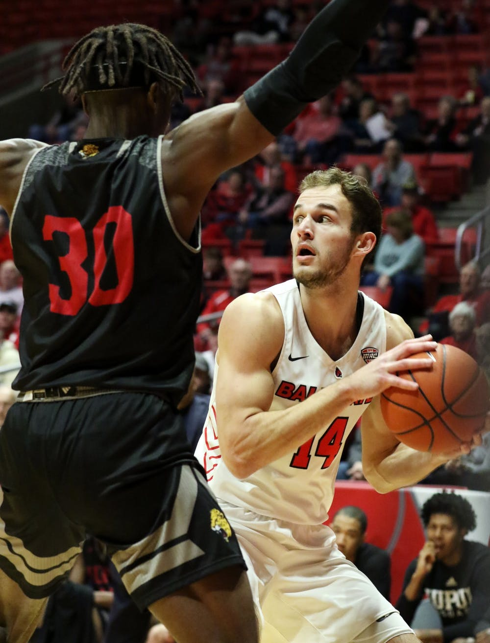 <p>Ball State senior forward Kyle Mallers looks for an opening while being guarded by IUPUI graduate forward Zo Tyson during the Cardinals' game against the Jaguars Dec. 7, 2019, at John E. Worthen Arena. Mallers scored 11 points. <strong>Paige Grider, DN</strong></p>